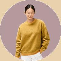 Woman wearing Outdoor Voices fleece sweater