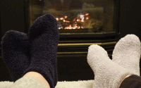 warm socks in front of a fireplace