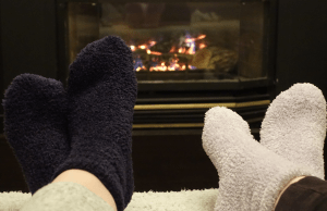 Best fuzzy socks in front of a fireplace