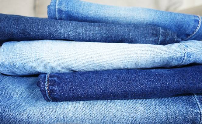 Stack of jeans in different washes