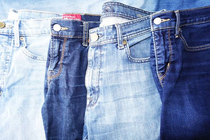 Four pairs of faded jeans in different washes